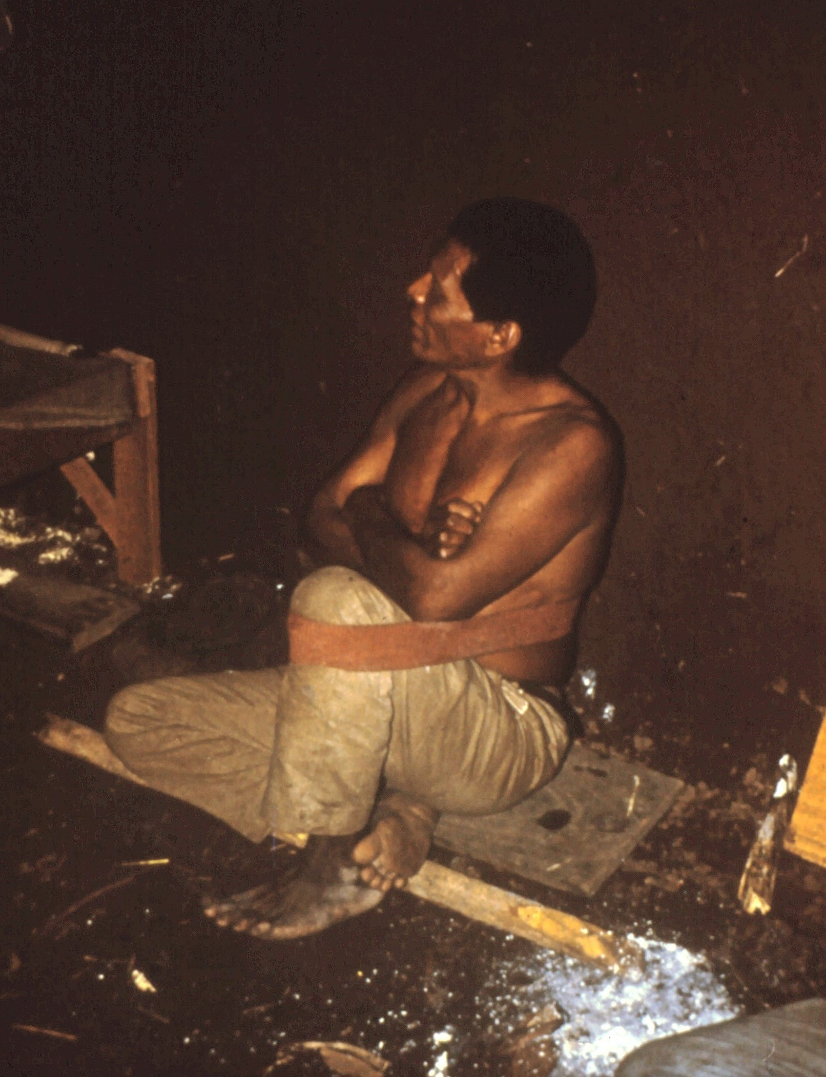 Ayoré Man relaxes with back support-which is woven by men