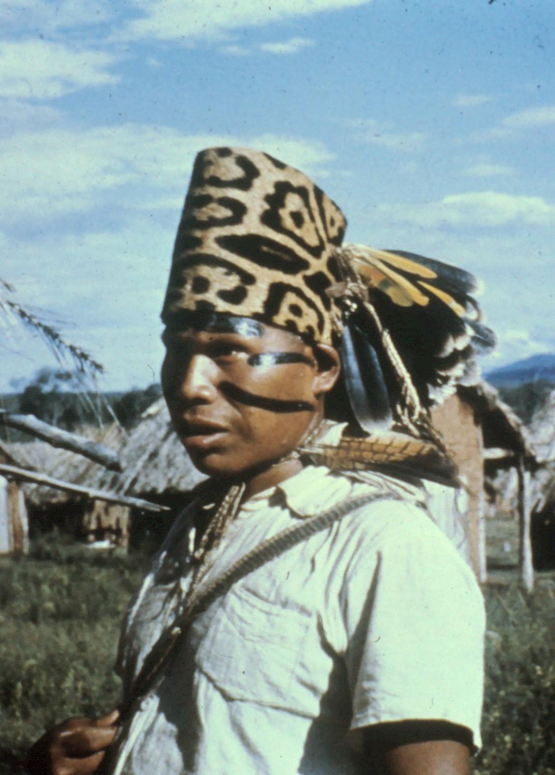 Ayoré asute (chief) in jaguar headdress with facial markings.