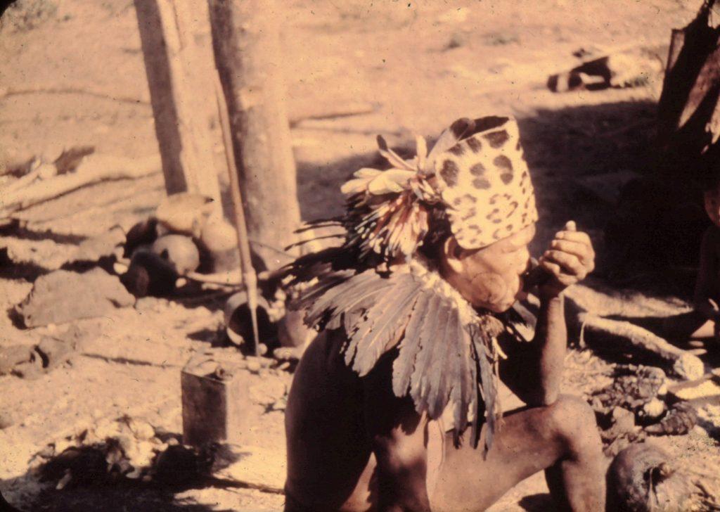 Ayoré man -Jaguar headdress, pipe, feathers, facial markings