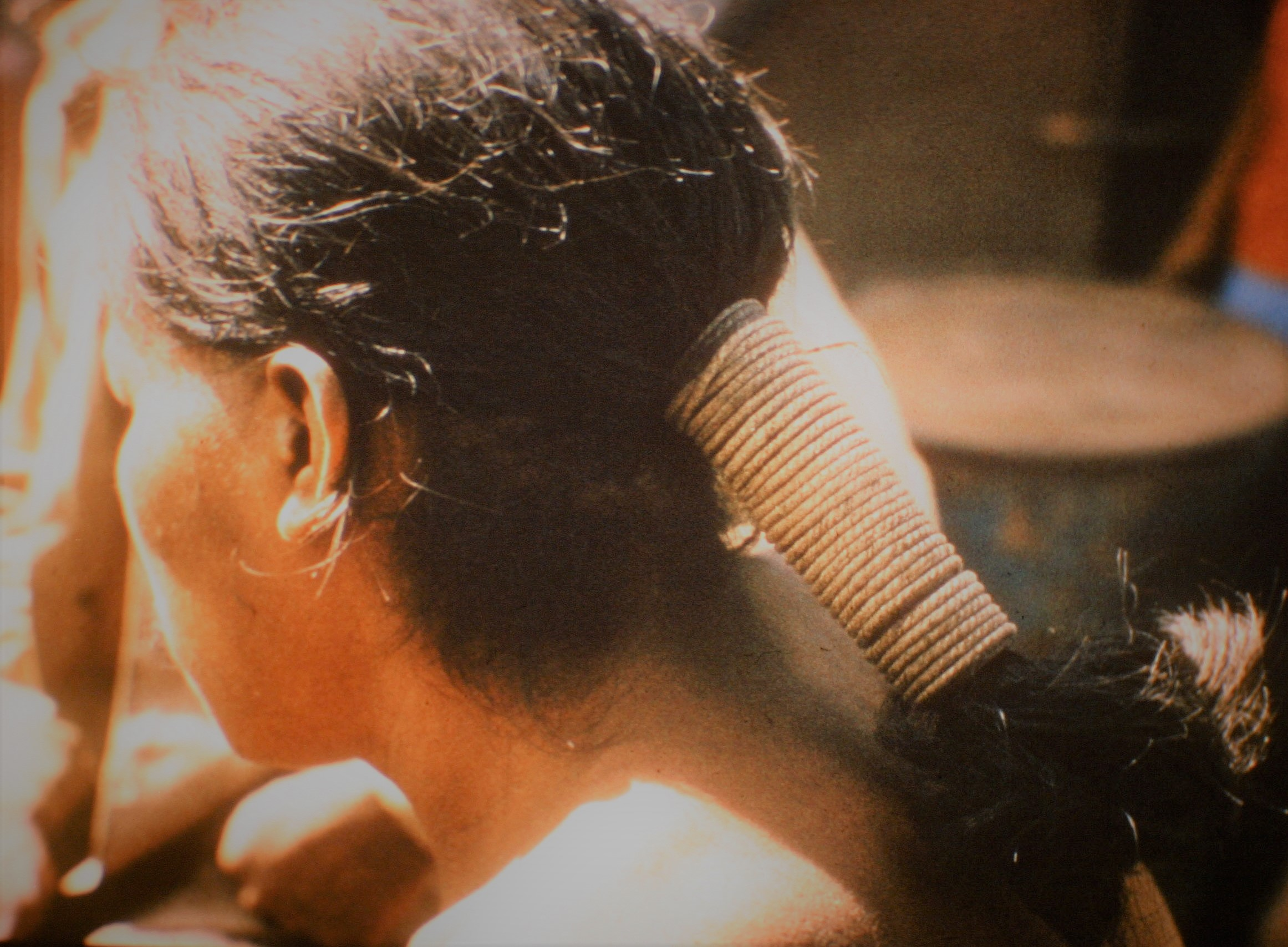Ayoré man -closeup of rope-tied hair