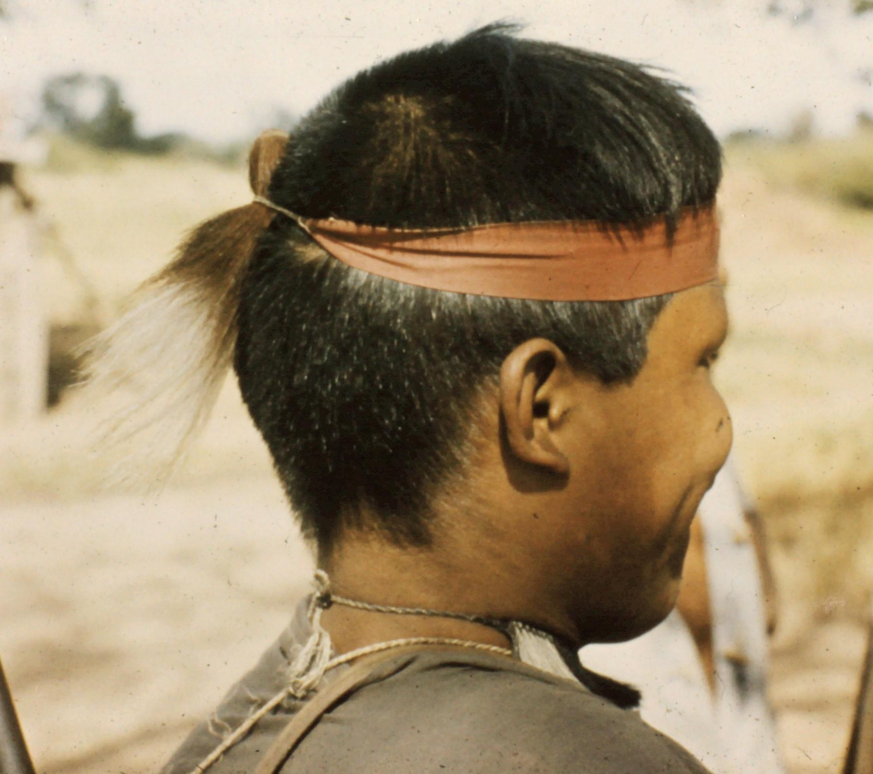 Ayoré man with hair necklace and headband.