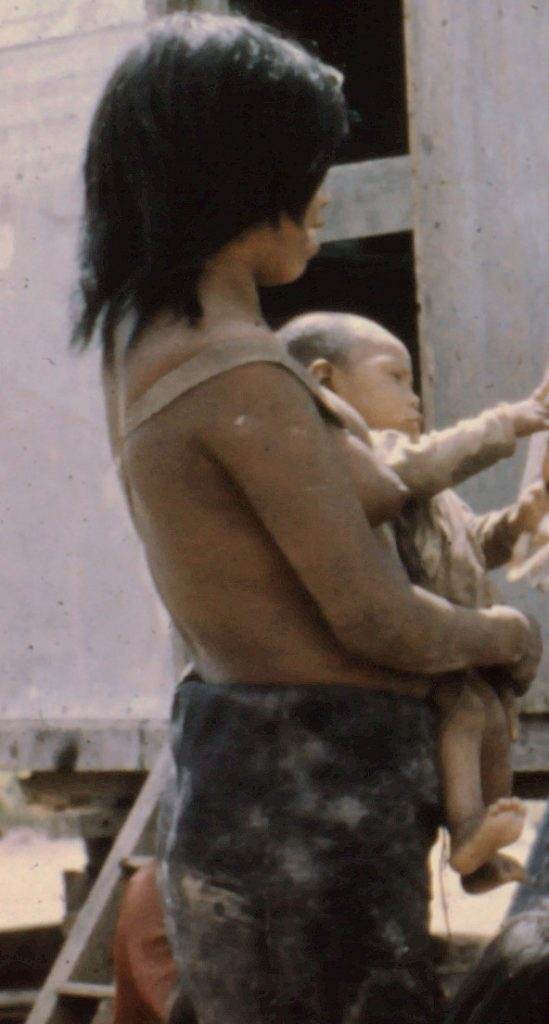 Ayoré mother with baby in sling.