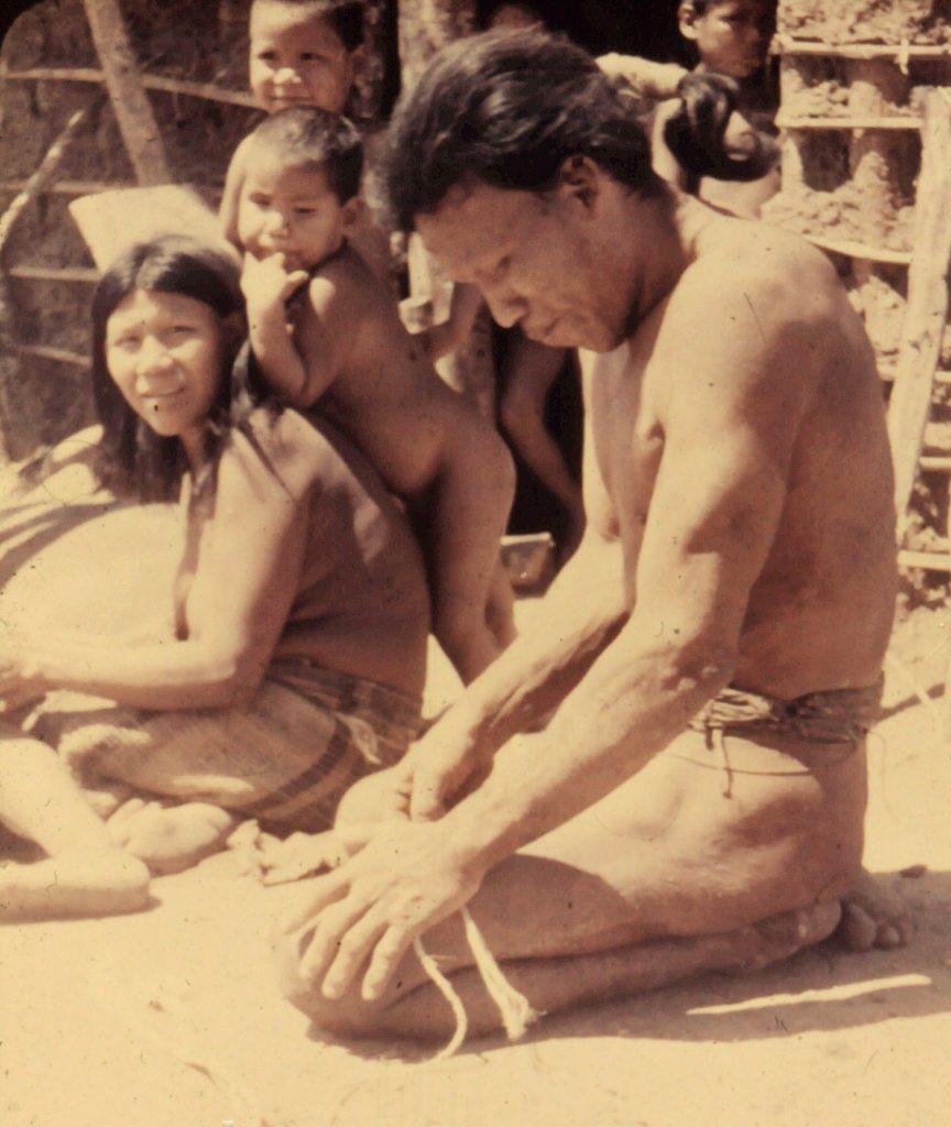 Ayore Men spin garabatá fibers on their thighs to make rope.