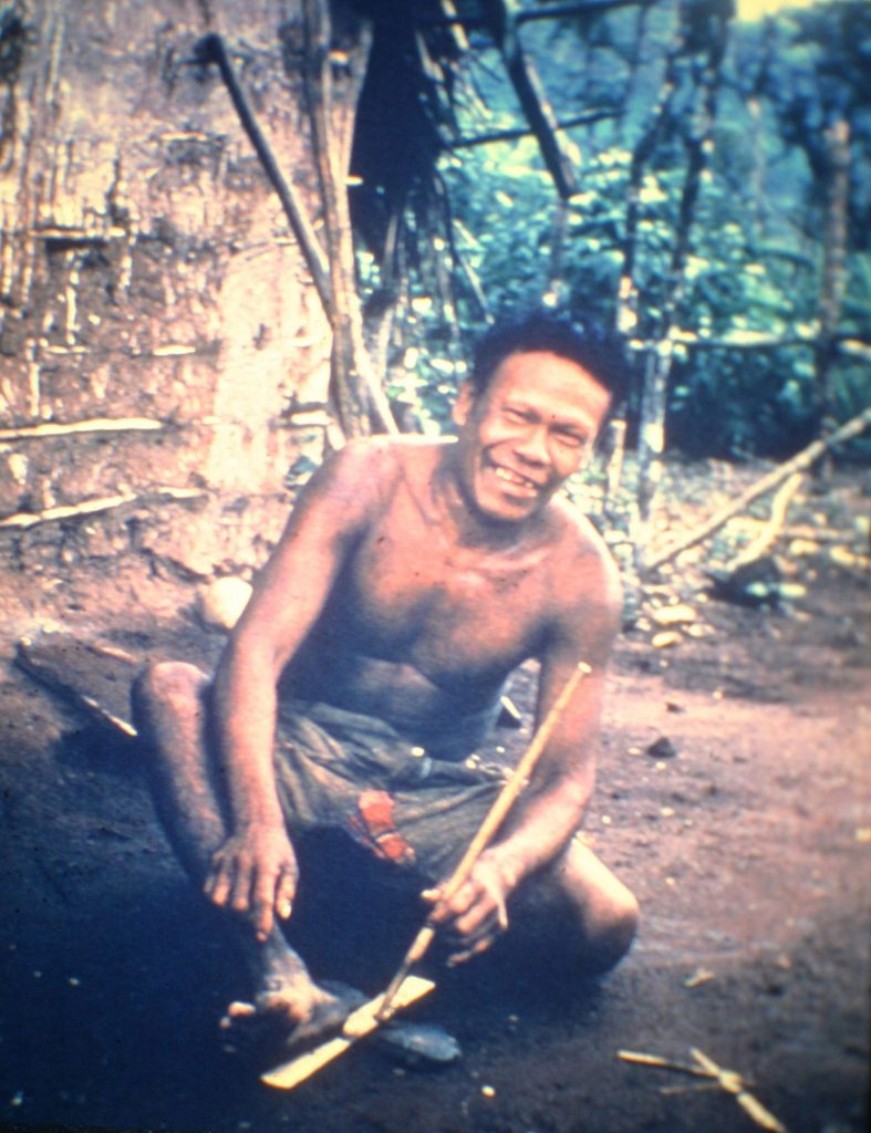 Ayore man making fire with sticks