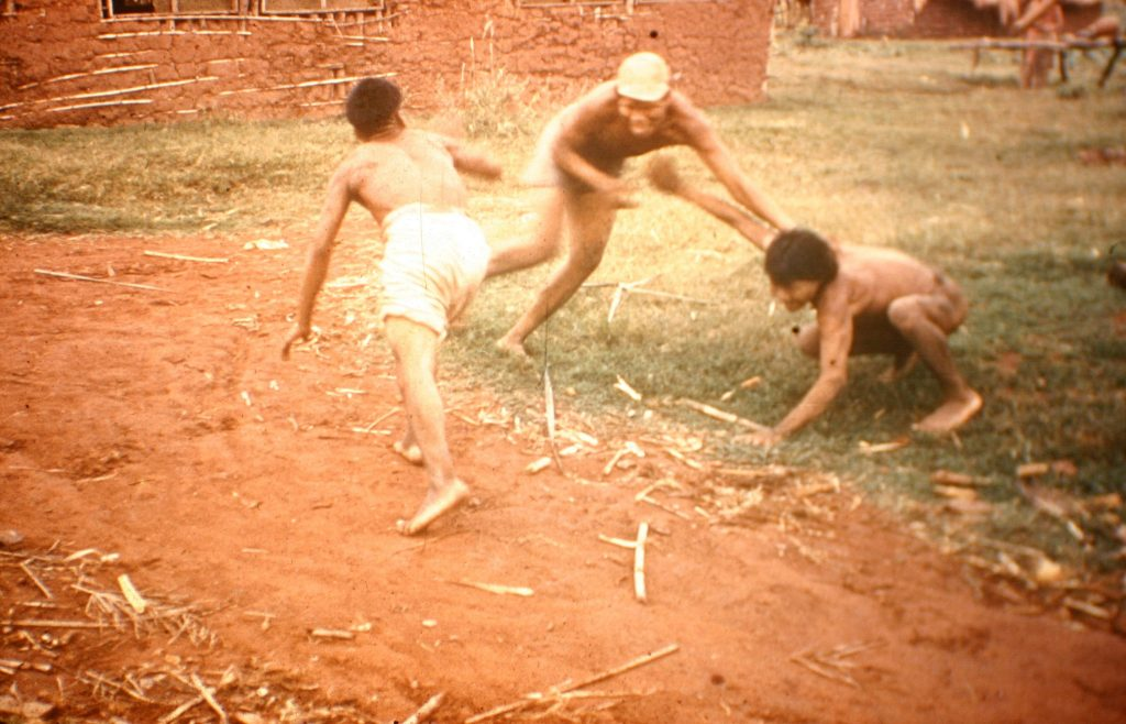 Ayore men playing touch.