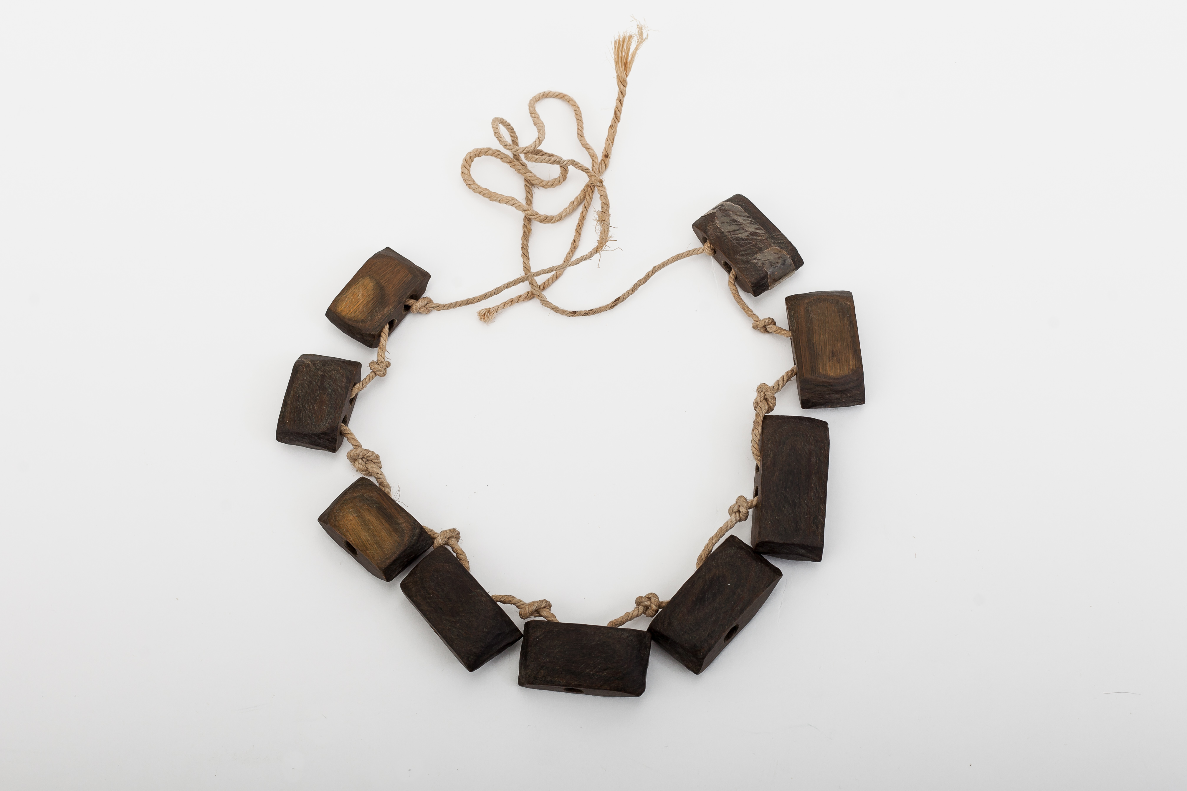 Little whistle necklaces worn by young men. They blow them.