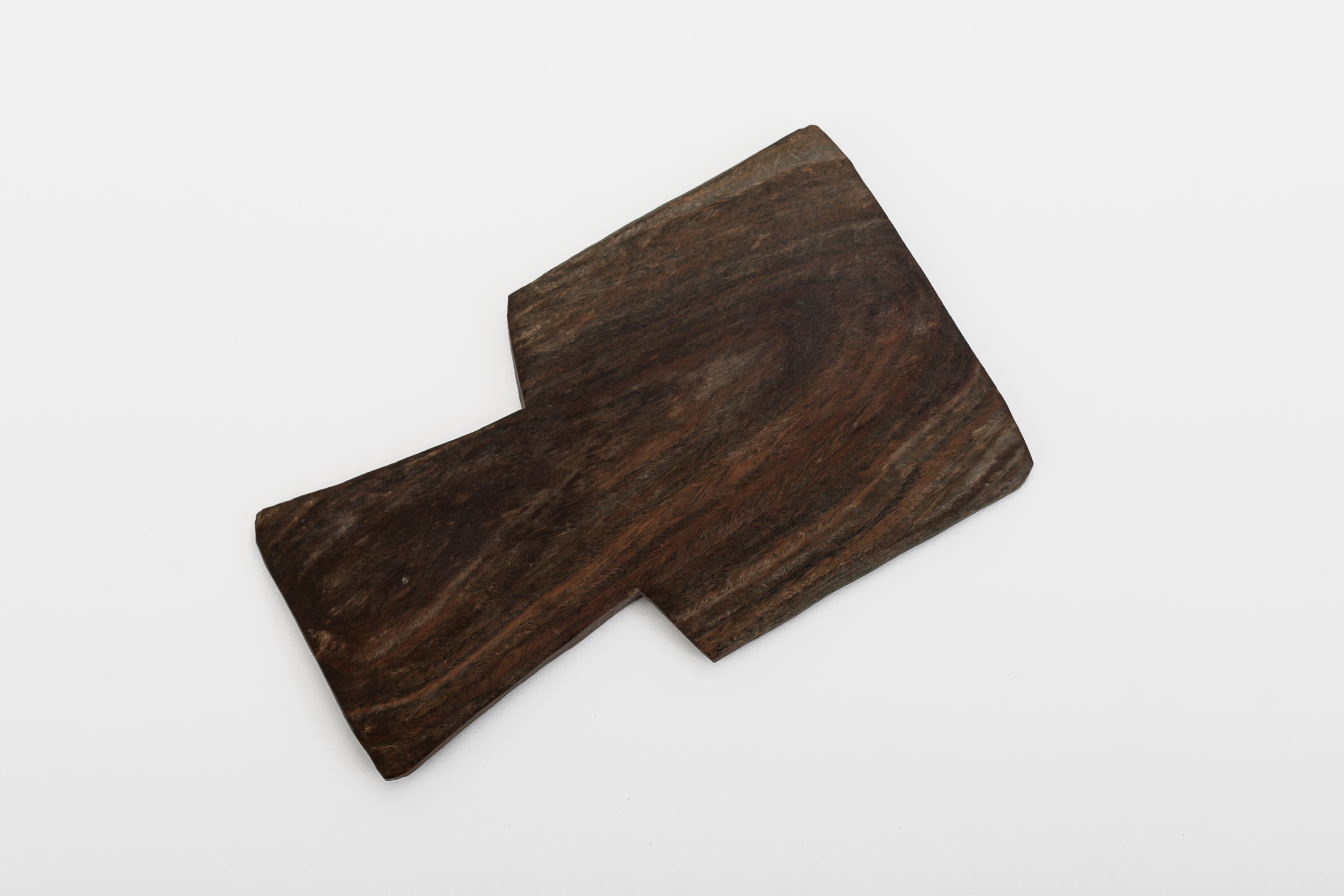 Wood carved into this shape to use for throwing in competitions.