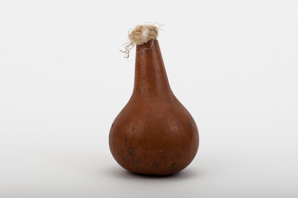 Gourd container – probably with seeds or hot peppers inside.