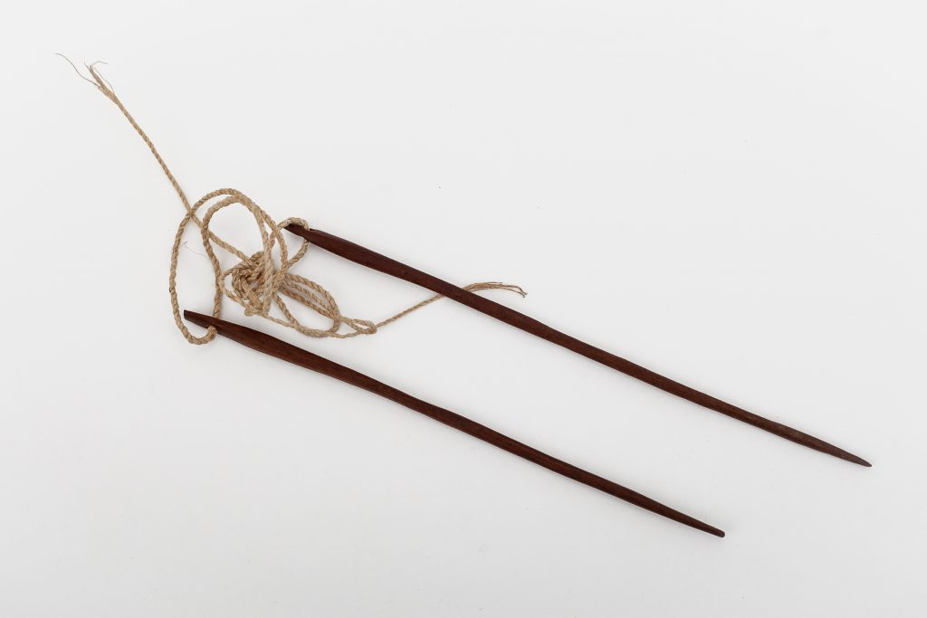 Wooden needles used for weaving.